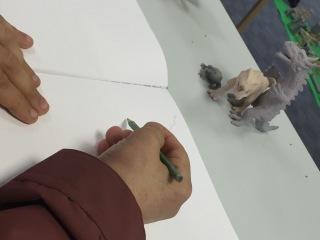 David beginning his dinosaur inspired sketches around DNA