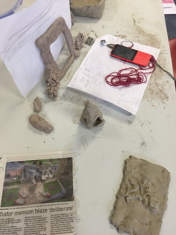 Sarah working with clay inspired by the recent fire at Wythenshawe Hall